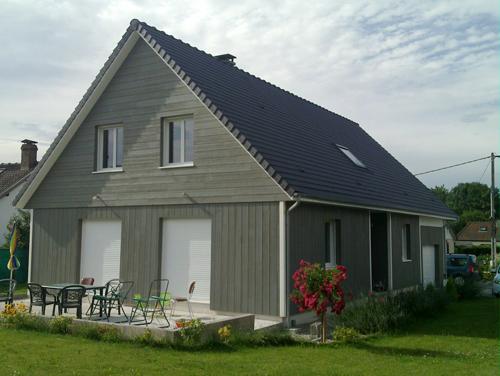Realisation d'une maison ossature bois avec bardage vertical